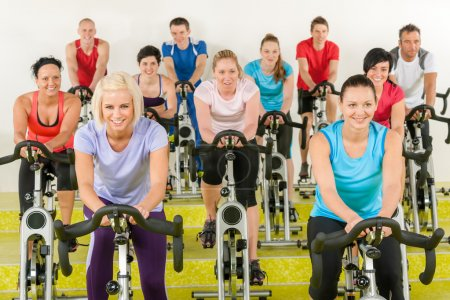 Photo for Spinning class group of young at the gym - Royalty Free Image