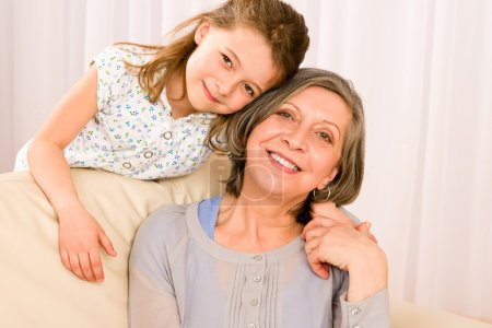 Grandmother with young girl smile relax together