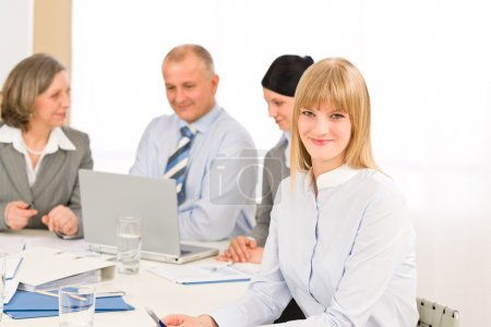 Businesswoman at team meeting with colleagues