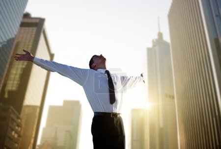Photo for Happy young businessman and big city - Royalty Free Image