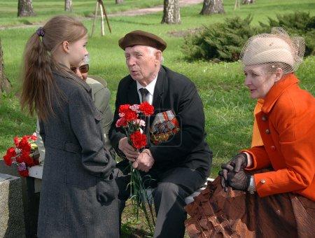 At Piskaryovskoye cemetery on Victory Day in St.Petersburg, Russia