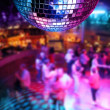 Dancing under colorful lights of disco mirror ball...