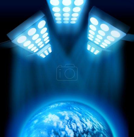 Photo pour Lumières de première mondiale illuminant globe bleu sur fond sombre - image libre de droit