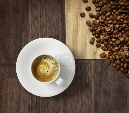 Photo for Cup of fresh espresso and roasted coffee beans on dark wooden background - Royalty Free Image