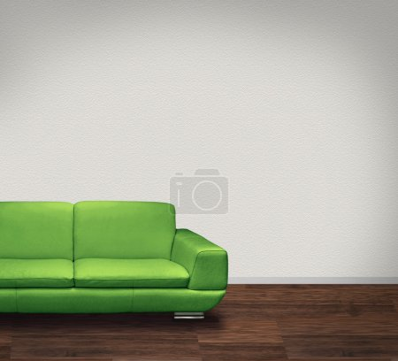 Photo for Modern green leather sofa in room with dark floor and white walls - Royalty Free Image