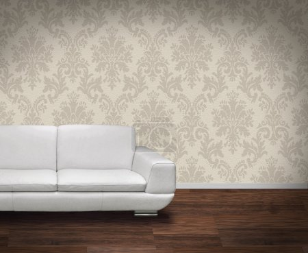 Photo for Modern white leather sofa in room with dark wooden floor - Royalty Free Image
