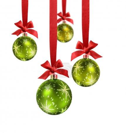 Green Christmas balls red ribbon