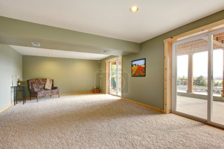 Photo for Ground level basmenet large new living room with green walls. - Royalty Free Image