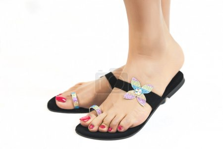 Womans feet with fashion shoes
