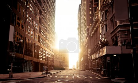 Photo for Early morning in still empty streets of New York, between the skyscrapers - Royalty Free Image
