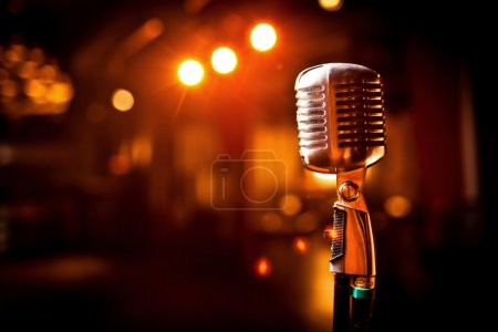 Photo for Retro microphone on stage in restaurant. Blurred background - Royalty Free Image