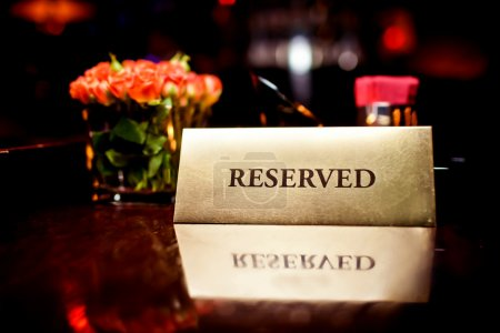Photo for Reserved sign on the table in restaurant - Royalty Free Image