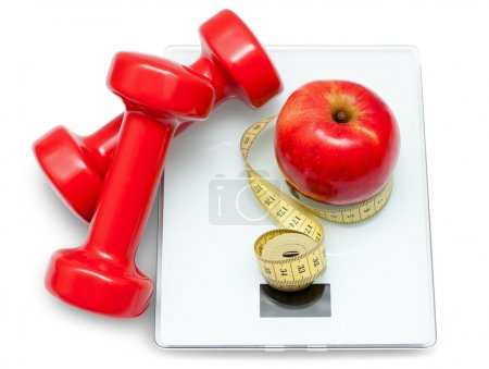 Photo for Scales, dumbbells, red apple and measuring tape isolated on the white background. Diet concept. - Royalty Free Image