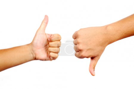 Photo for Thumbs up and down in isolated white background - Royalty Free Image