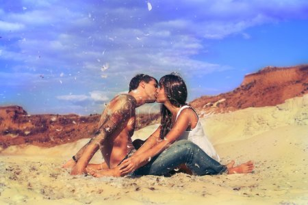 Young beautiful girl and guy in love outdoors