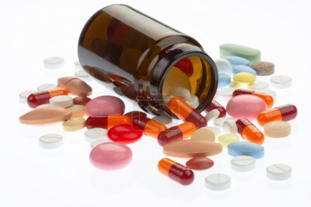 Photo for Pills pouring out of the brown bottle - Royalty Free Image