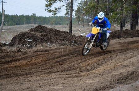 Motorcyclist rides motocross track on