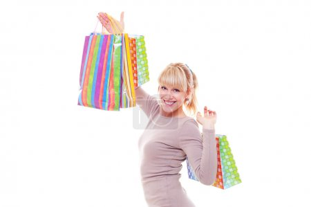 Photo for Studio shot of smiley woman after shopping. isolated on white - Royalty Free Image