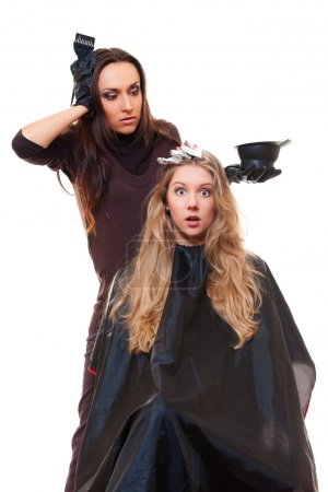 Studio shot of hairdresser and shocked client