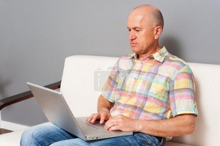 Serious senior man working