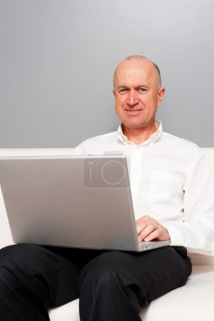 Picture of smiley senior man with laptop