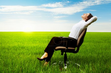 Businesswoman relaxing on chair