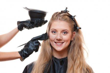 Hairdresser doing hair dye