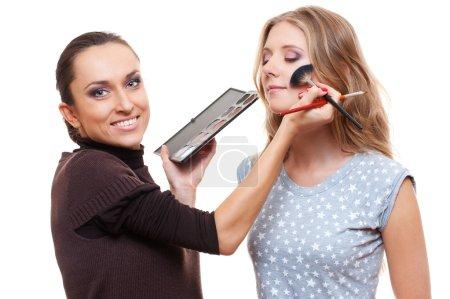 Esthetician applying eyeshadow