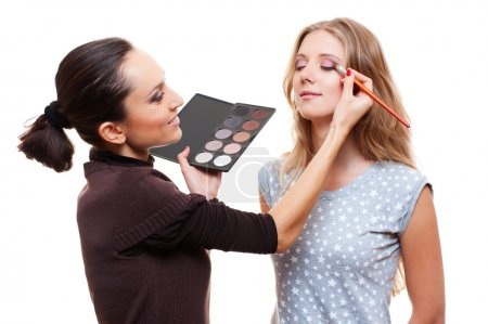 Make-up artist applying eye shadow