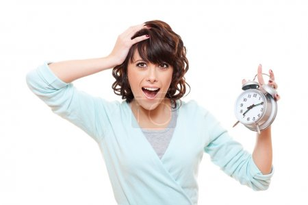 Shocked woman with alarm clock