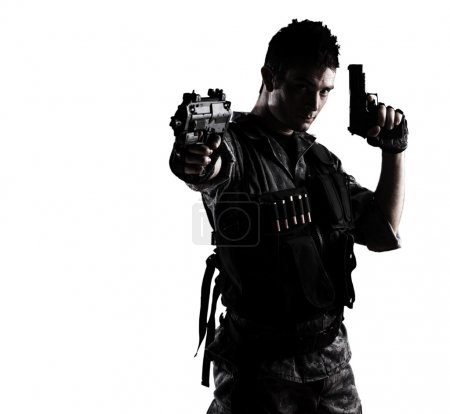 Photo for Young soldier shooting with a pistol on a white background - Royalty Free Image
