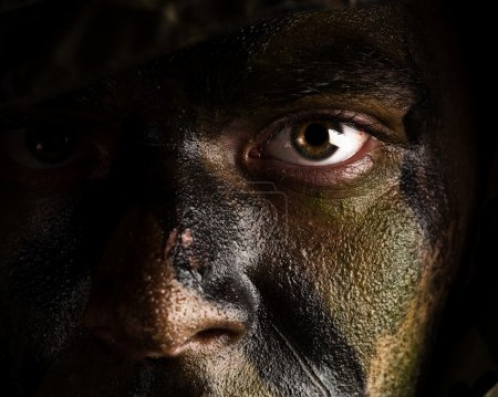 Photo for Young soldier face with jungle camouflage paint - Royalty Free Image
