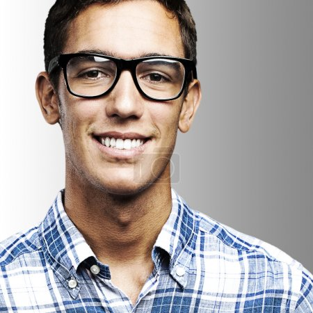 Photo for Portrait of young man with shirt and glasses over a grey background - Royalty Free Image
