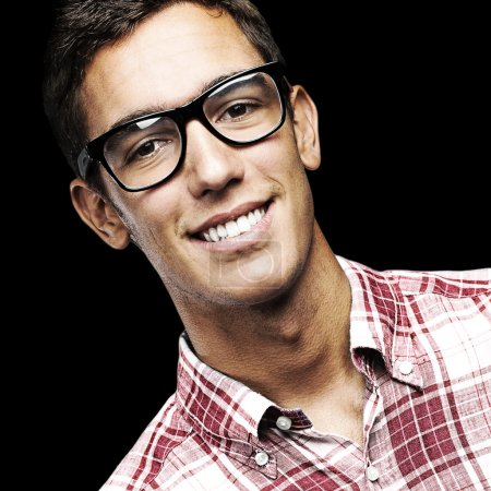 Photo for Portrait of young man with shirt and glasses over a black background - Royalty Free Image