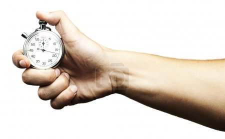Photo for Hand holding a stopwatch against a white background - Royalty Free Image