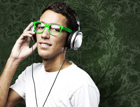 Photo for Portrait of young man listen to music against a vintage wall - Royalty Free Image