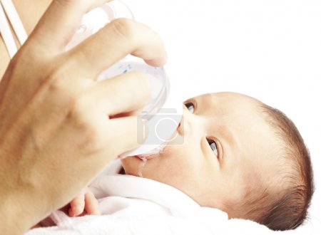 Newborn baby drinking