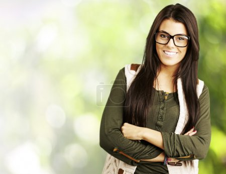 Photo for Portrait of young woman standing isolated against a nature background - Royalty Free Image