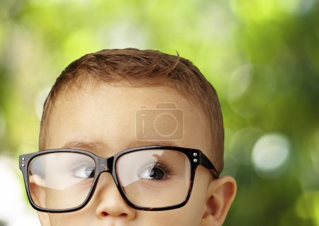 Photo for Portrait of a kid wearing glasses and looking up - Royalty Free Image