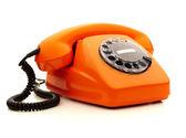 Vintage orange telephone over white background