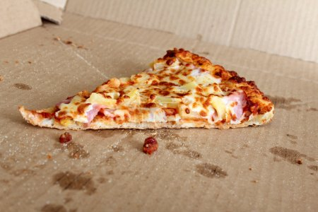 Photo for Last slice of pizza left in the box - Royalty Free Image
