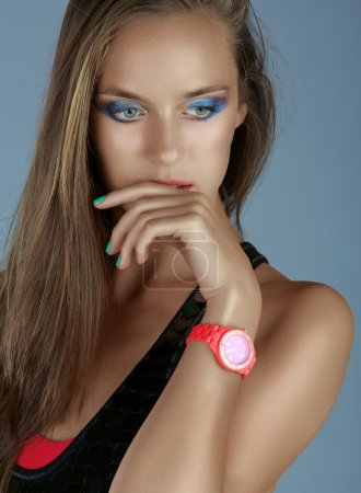 Woman with neon pink watch