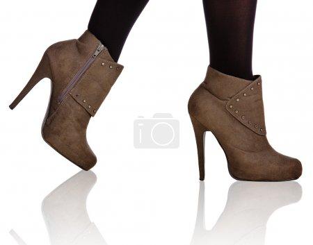 Brown high heel boots closeup