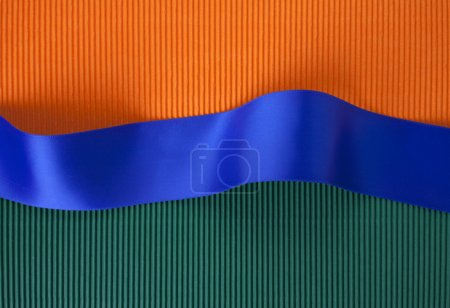 Photo for Blue ribbon banner on corrugated cardboard - Royalty Free Image