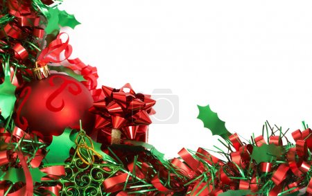 Photo for Red Christmas bauble on green tinsel isolated on white background with copy space. - Royalty Free Image