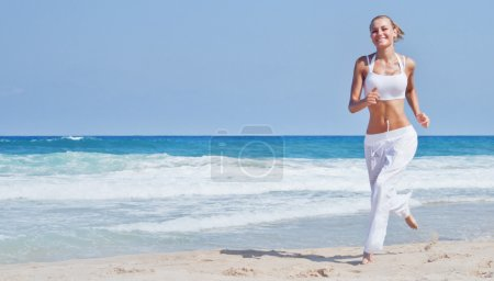 Photo for Healthy woman running on the beach, girl doing sport outdoor, happy female exercising, freedom, vacation, fitness and heath care concept with copy space over natural background - Royalty Free Image