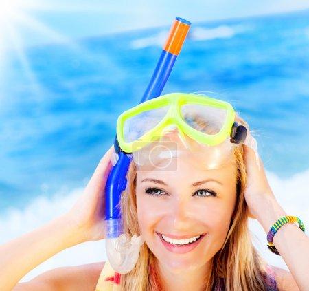 Cute teen girl having fun on the beach