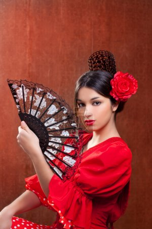 Photo for Flamenco dancer Spain woman gypsy with red rose spanish hand fan and peineta comb - Royalty Free Image