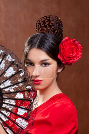 Photo for Gypsy flamenco dancer Spain girl with red rose spanish hand fan and peineta comb - Royalty Free Image