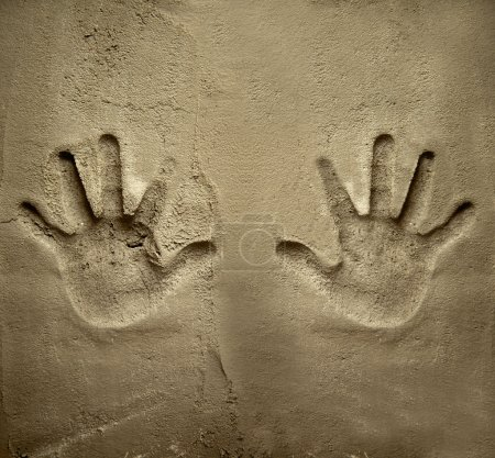 Photo for Both hands print on cement mortar wall with shadow relief - Royalty Free Image